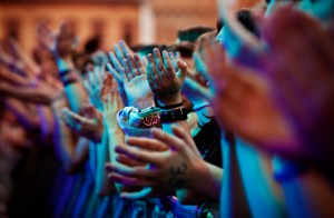 Clapping hands of the audience of a modern music concert